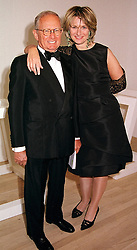 MR GILBERT & the HON.MRS de BOTTON, leading <br /> patrons of art, at a dinner in London on 3rd May 2000.ODH 111