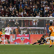 Brad Davis, (left), Houston Dynamo, scores his sides first goal after a bad defensive error during the New York Red Bulls V Houston Dynamo, Major League Soccer second leg of the Eastern Conference Semifinals match at Red Bull Arena, Harrison, New Jersey. USA. 6th November 2013. Photo Tim Clayton