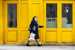 © Licensed to London News Pictures. 20/05/2021. London, UK. A woman wearing a face visor walks along Hounslow High Street, West London. Hounslow is the first London borough to actively test for the Indian Covid variant B.1.617.2. Photo credit: Ray Tang/LNP