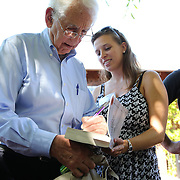 Government whistleblower Daniel Ellsberg signs a copy of his book for a student during the first week orientation for incoming students at North Gate Hall in Berkeley, California, on Wednesday, August 27, 2014. Ellsberg, who is most famous for his role in the Pentagon Papers ordeal, interacted with students about such topics as freedom of the press, whistleblowers Eric Snowden and Chelsea Manning, and the responsibilities and ethical morals of reporters and other members of the media. (AP Photo/Alex Menendez)