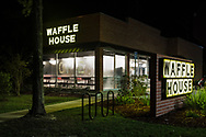 Waffle House in Mandeville Louisiana, the night before Gov. John Bel Edwards issued a stay-at- home order to combat the COVID-19 pandemic.  Restaurants now can only serve take out, including the Waffle house.  The company closed over 300 for the duration of the pandemic..
