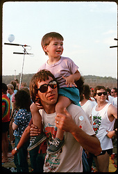Son riding his Dad's shoulders for better sidelong glancing views of The Grateful Dead Concert at Oxford Plains Speedway, Oxford Maine July 3, 1988