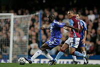 Photo: Marc Atkins.<br /> Chelsea v Aston Villa. Carling Cup. 08/11/2006.<br /> Geremi of Chelsea in action with Wilfred Bouma of Villa.
