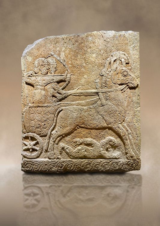 Photo of Hittite relief sculpted orthostat stone panel of Long Wall Limestone, Karkamıs, (Kargamıs), Carchemish (Karkemish), 900 - 700 B.C. Chariot. Anatolian Civilisations Museum, Ankara, Turkey<br /> <br /> One of the two figures in the chariot holds the horse's headstall while the other throws arrows. There is a naked enemy with an arrow in his hip lying face down under the horse's feet It is thought that this figure is depicted smaller than the other figures since it is an enemy soldier. The lower part of the orthostat is decorated with braiding motifs. <br /> <br /> On a brown art background. .<br />  <br /> If you prefer to buy from our ALAMY STOCK LIBRARY page at https://www.alamy.com/portfolio/paul-williams-funkystock/hittite-art-antiquities.html  - Type  Karkamıs in LOWER SEARCH WITHIN GALLERY box. Refine search by adding background colour, place, museum etc.<br /> <br /> Visit our HITTITE PHOTO COLLECTIONS for more photos to download or buy as wall art prints https://funkystock.photoshelter.com/gallery-collection/The-Hittites-Art-Artefacts-Antiquities-Historic-Sites-Pictures-Images-of/C0000NUBSMhSc3Oo
