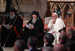Pope Francis (R) and Archbishop of Constantinople and Ecumenical Patriarch Bartholomew I attend a meeting of prayer in the Basilica of St. Francis during the 30th World Day of Prayer for Peace a inter-religious meeting in the Italian pilgrimage town of Assisi, Italy on September 20, 2016. Pope Francis welcomed some 450 leaders representing a rainbow of faiths to the hilltop Italian town of Assisi to commemorate the 30th anniversary of a daylong prayer for peace here called by Pope John Paul II in 1986. Photo by Eric Vandeville/ABACAPRESS.COM