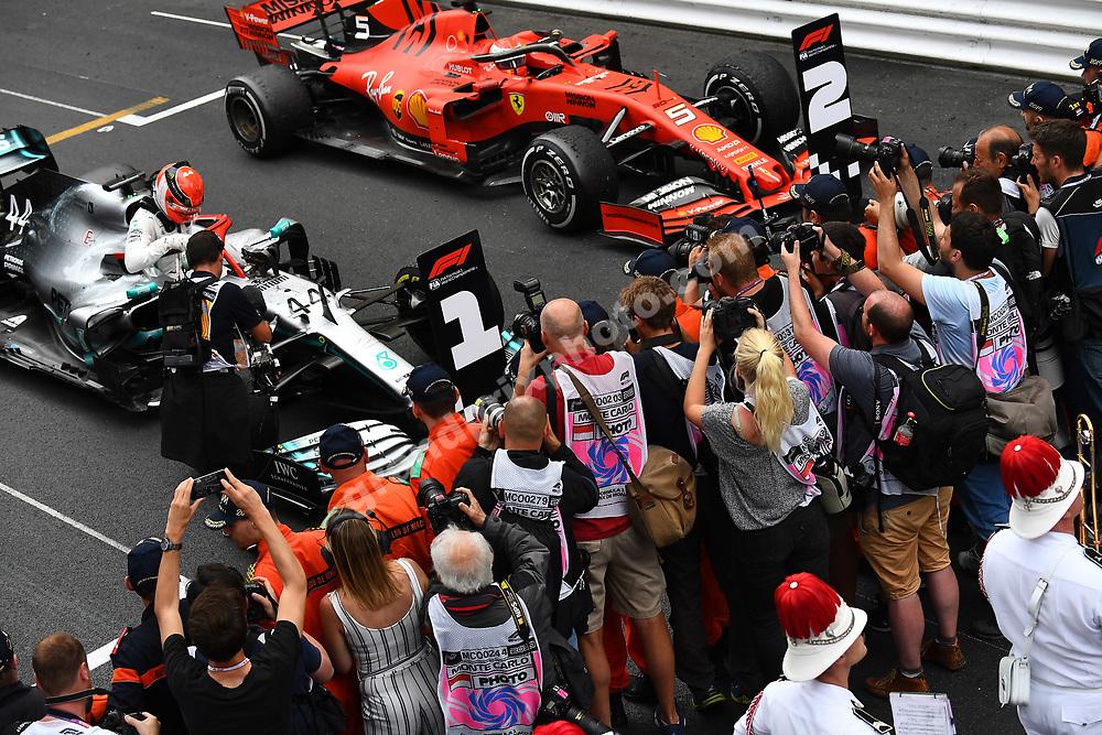 Lewis Hamilton (Mercedes), Sebastian Vettel (Ferrari) and photographers including Lise Nygaard after the 2019 Monaco Grand Prix. Photo: Grand Prix Photo