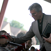 Inductee Michael Buffer signs autographs during the 23rd Annual International Boxing Hall of Fame Induction ceremony at the International Boxing Hall of Fame on Sunday, June 10, 2012 in Canastota, NY. (AP Photo/Alex Menendez)