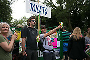 Party people outside the toilets at the Glastonbury Festival 23th July 2016, Somerset, United Kingdom.  The Glastonbury Festival runs over 3 days and has 3000 acts, including music, art and performance and approx. 150.000 attend the anual event.