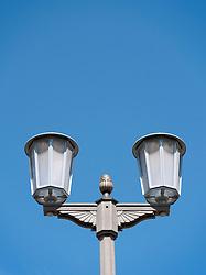 Detail of former East German decorative street light on historic Karl Marx Allee in Berlin Germany