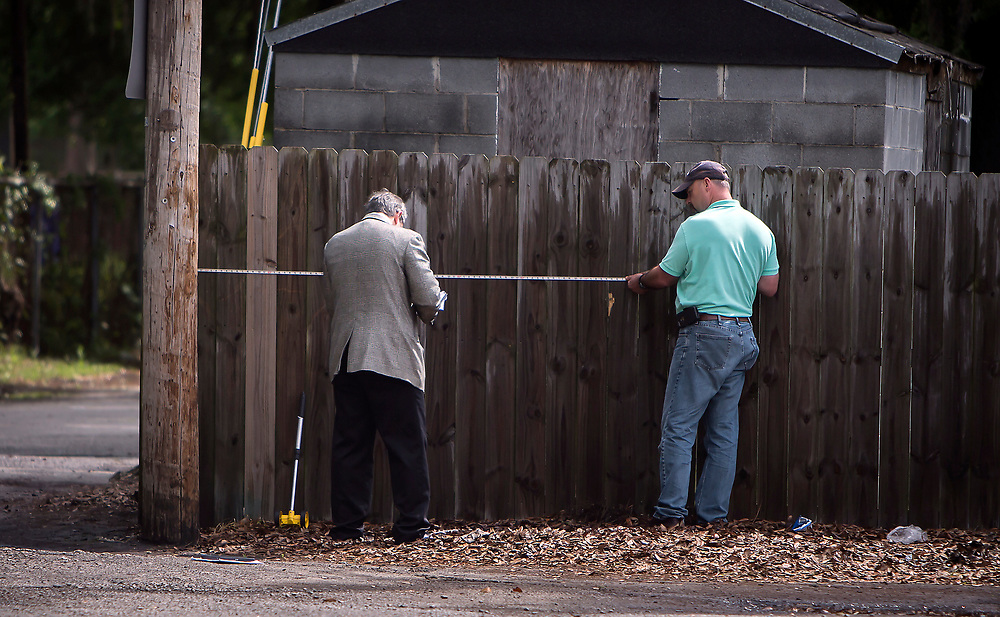 NORTH CHARLESTON, SC. - APRIL, 20, 2015: Forensic experts work the site where Walter Scott was shot to death by a white North Charleston police officer in North Charleston, S.C.  CREDIT: Stephen B. Morton for The New York Times