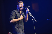 Country music singer Brett Eldredge performing in support of Taylor Swift on the RED Tour 2013 at Scottrade Center in St. Louis on March 18, 2013.