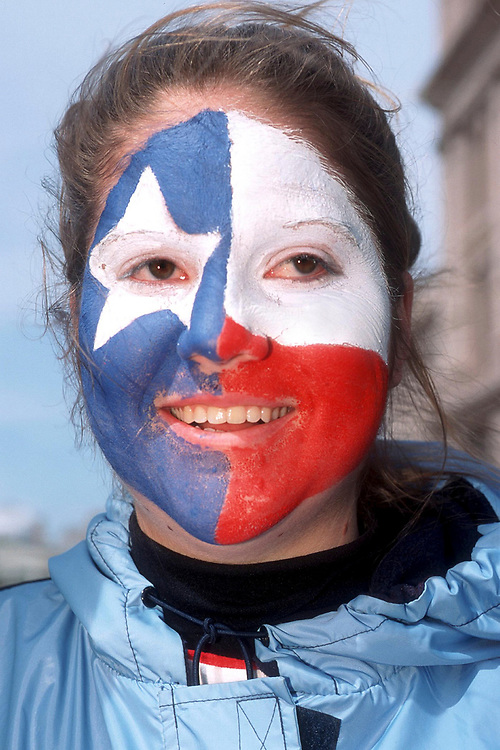 Austin, Texas March 2nd, 2002:  Patriotic Texans brave a chilly Texas winter wind as they march up Congress Avenue to the Texas Capitol Saturday during Texas Independence Day festivities in Austin. The day marks the Lone Star State's independence from Mexico in 1836.  ©Bob Daemmrich