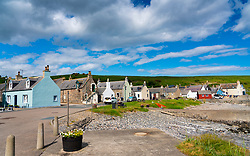 Traditional cottages beside harbour at village of Sandend on Moray Firth in Aberdeenshire, Scotland, UK