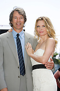 """Michelle with her husband..Michelle Pfeiffer honored with star on the Hollywood Walk Of Fame. This was the 2,345 Star on the Hollywood Walk Of Fame. .Michelle starred in """"Scarface"""", """"Love Field"""", """"The Fabulous Baker Boys"""", and Frankie and Johnny."""" .Jeff Bridges and Paul Rudd were also there to honor her..Hollywood and Highland Complex, Hollywood, CA"""