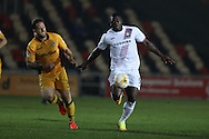 John Akinde of Barnet ® breaks away from Darren Jones of Newport county. EFL Skybet football league two match, Newport county v Barnet at Rodney Parade in Newport, South Wales on Tuesday 25th October 2016.<br /> pic by Andrew Orchard, Andrew Orchard sports photography.