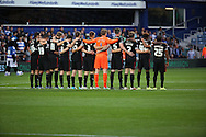 Carlisle United during the one minutes silence to remember Shoreham airshow during the Capital One Cup match between Queens Park Rangers and Carlisle United at the Loftus Road Stadium, London, England on 25 August 2015. Photo by Matthew Redman.