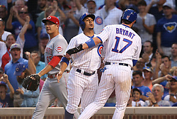 August 14, 2017 - Chicago, IL, USA - Chicago Cubs left fielder Jon Jay (30) and Chicago Cubs third baseman Kris Bryant (17) celebrate after they both scored on the double by Chicago Cubs first baseman Anthony Rizzo (44) during the first inning of their game at Wrigley Field Monday Aug. 14, 2017 in Chicago. (Credit Image: © Nuccio Dinuzzo/TNS via ZUMA Wire)