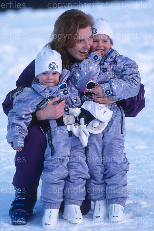 Sarah, Duchess of York with her two daughters Princess Beatrice and Princess Eugenie as they enjoy a ski holiday in Klosters, Switzerland in 1992. Photograph by Jayne Fincher