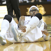Central Florida guard Marcus Jordan (5) grabs his injured ankle during the first half of an NCAA basketball game against the Furman Paladins at the UCF Holiday Classic at the UCF Arena on December 29, 2010 in Orlando, Florida. (AP Photo/Alex Menendez)