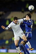 Leeds United's Lewis Cook (l) challenges Cardiff City's Scott Malone. Skybet football league championship match, Cardiff city v Leeds Utd at the Cardiff city stadium in Cardiff, South Wales on Tuesday 8th March 2016.<br /> pic by Carl Robertson, Andrew Orchard sports photography.