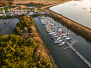 Drone aerial view of Emsworth Marina in West Sussex, England at sunset