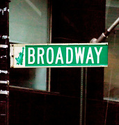 Street sign showing Broadway, at a road crossing in New York City.