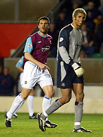 Photograph: Scott Heavey.<br />Wimbledon v West Ham United. Nationwide Division One. 15/11/2003.<br />Ian Pearce argues with his own keeper, David James