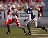 Nebraska running back Cody Glenn (34) scrambles up field for a first down past Kansas State linebacker Reggie Walker (53) at Bill Snyder Family Stadium in Manhattan, Kansas, October 14, 2006.  The Huskers beat the Wildcats 21-3.<br />