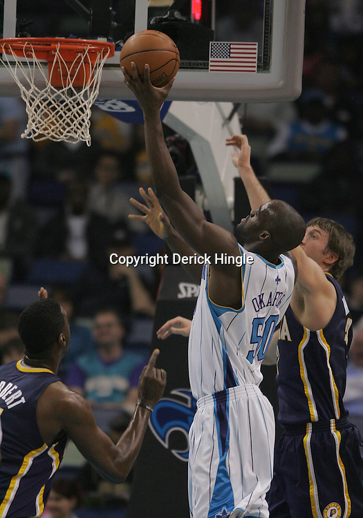 Feb 19, 2010; New Orleans, LA, USA; New Orleans Hornets center Emeka Okafor (50) shoots overn Indiana Pacers forward Troy Murphy (3) and center Roy Hibbert (55) during the second half at the New Orleans Arena. The Hornets defeated the Pacers 107-101.  Mandatory Credit: Derick E. Hingle-US PRESSWIRE