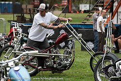 Grant Peterson moving BF11 invited builder Oliver Jones Harley-Davidson UL Flathead / Knucklehead chopper at the Born Free set-up day before the big show. Oak Canyon Ranch, Silverado, CA, USA. Friday, June 21, 2019. Photography ©2019 Michael Lichter.