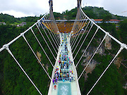 ZHANGJIAJIE, CHINA - JUNE 25:<br /> <br /> Aerial view of the glass-bottomed bridge receiving a safety test at Zhangjiajie Grand Canyon on June 25, 2016 in Zhangjiajie, Hunan Province of China. World\'s tallest and longest glass-bottomed bridge has been completed and took a global broadcast through television and internet medias to show its safety. More than thirty citizens and visitors thumped the bridge with hammer in the test event. <br /> ©Exclusivepix Media