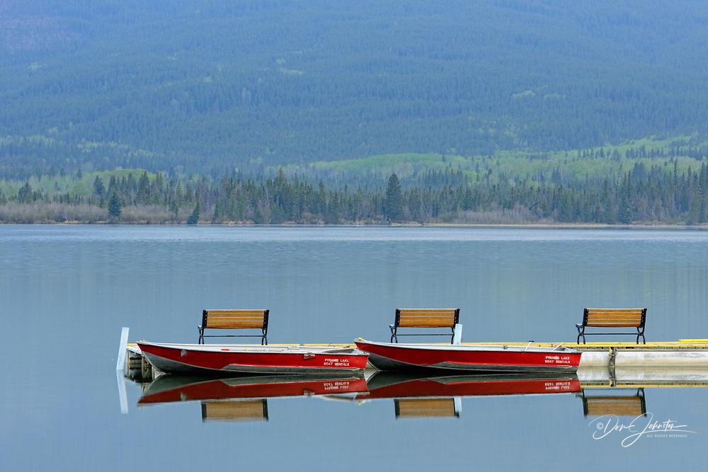 Reflections in Pyramid Lake with Pyramid Lake Resort boat docks, Jasper National Park, Alberta, Canada