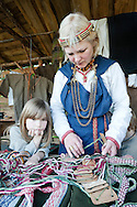 Festival of Archaeology and Antique Crafts, Kernave, Lithuania. Kernave was first settled around 9000 BC and the series of mounds here - site of the former Lithuanian capital, sacked by the Teutonic Knights in 1390 - are a UNESCO World Heritage Site. © Rudolf Abraham.