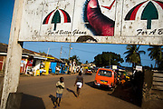 People walk past a billboard advertising National Democratic Congress (NDC) candidate Atta Mills ahead of the upcoming presidential elections in Accra, Ghana on Monday September 8, 2008.