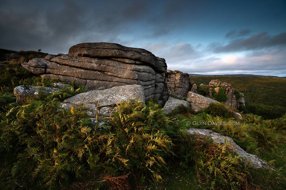 August on Dartmoor. After months of earth-scorching summer the elements during our three day trip to this magical national park in the South West turned out to be mixed to say the least. Brooding clouds hovered over dark hillsides and the sun glowed rather than shone, through thin patches of grey blanket overhead. <br /> <br /> I was taken aback by how lush the valleys were, so much more tree cover than here in North Wales. The variation in the vegetation was also surprising, creating quite a tapestry of earthy greens and browns. Of course, the most exciting aspect of this landscape for me, is the granite beneath, sometimes punching upwards as huge sculptural tors, monuments amidst acres of silent grasses and foliage. I find Dartmoor uniquely spiritual, enchanting even and I can'g wait to return.