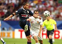 Photo: Chris Ratcliffe.<br /> USA v Czech Republic. Group E, FIFA World Cup 2006. 12/06/2006.<br /> Vratislav Lokvenc of Czech Republic clashes with Uguchi Onyewu of the USA.