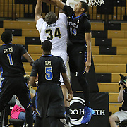 ORLANDO, FL - DECEMBER 31: Brandon Swannegan #44 of the Tulsa Golden Hurricane blocks a shot by Justin McBride #34 of the UCF Knights during an NCAA basketball game at the CFE Arena on December 31, 2014 in Orlando, Florida. (Photo by Alex Menendez/Getty Images) *** Local Caption *** Brandon Swannegan; Justin McBride