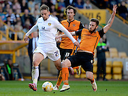 Charlie Taylor attempts a shot during the Sky Bet Championship match between Wolverhampton Wanderers and Leeds United at Molineux, Wolverhampton, England on 6 April 2015. Photo by Alan Franklin.