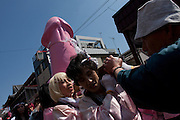 A large pink phallus is carried on a mikoshi or portable shrine by transvestites from the Elizabeth Club during the Kanamara matsuri or festival of the iron phallus in Kawasaki Daishi near Tokyo, Japan. Sunday April 1st 2012