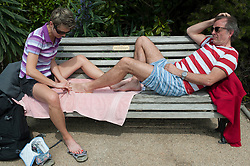 (c) Licensed to London News Pictures. 05/05/2014. Essex, UK. May Day Bank Holiday at traditional resort, Southend on Sea. This couple took relaxing to a new level as the man has a pedicure from his firend on a seafront bench. Photo credit Simon Ford/LNP