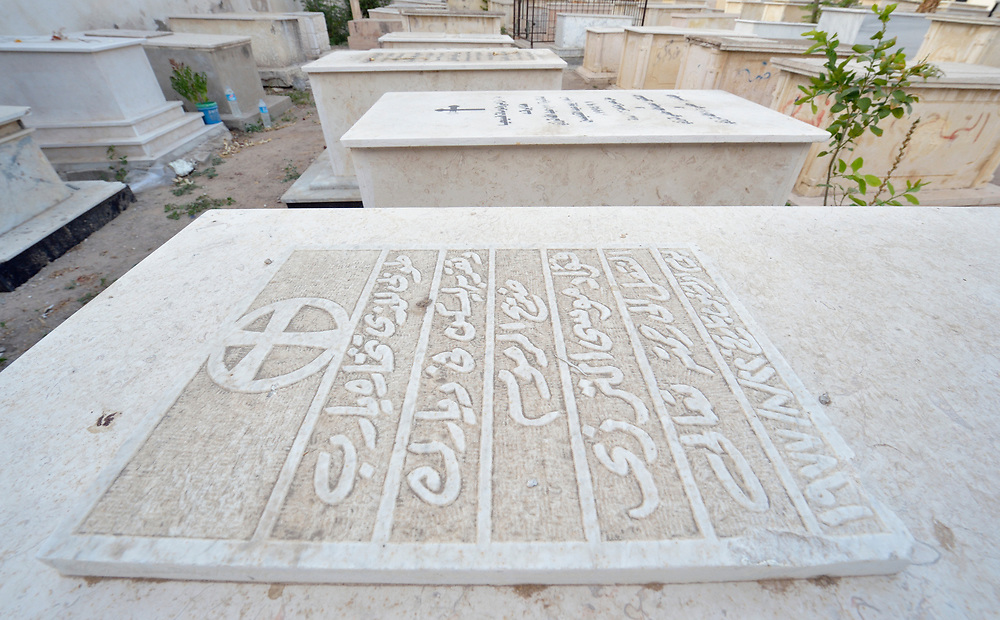Tombs in the cemetery of the Saint Porphyrios Orthodox Church in Gaza City, Gaza. Fifty tombs in the cemetery were damaged by Israeli bombing during the war in 2014, and International Orthodox Christian Charities, a member of the ACT Alliance, has paid to have them repaired. The church, which was also damaged by the bombing, served as a refuge for 240 people during the war, and as a feeding center for an additional 100 people. IOCC provided the food and other supplies for the displaced families.