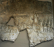 Limestone relief from the Palace of Sennacherib, Nineveh, 700-692 BC. The King is shown in his chariot pulled by men. An attendant holds an umbrella over the king's head. Armed guards follow the chariot.