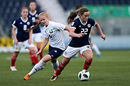 Erin Cuthbert (#22) of Scotland turns away from the challenge of Ksenia Kubichnaya (#16) of Belarus during the FIFA Women's World Cup UEFA Qualifier match between Scotland Women and Belarus Women at Falkirk Stadium, Falkirk, Scotland on 7 June 2018. Picture by Craig Doyle.