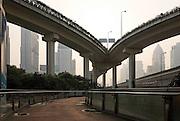 Raised concrete road at dawn. Shanghai, China, 2007