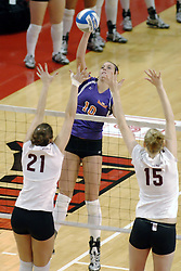 24 November 2006: Danielle Diehl strikes towards Jamie Adams and Shandra Harper during a Quarterfinal match between the Evansville University Purple Aces and the Missouri State University Bears.The Tournament was held at Redbird Arena on the campus of Illinois State University in Normal Illinois.<br />