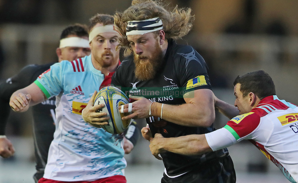 Newcastle Falcons Evan Olmstead pushes off Harlequins Karl Dickson (right) during the Aviva Premiership match at Kingston Park, Newcastle.