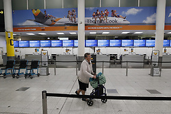 © Licensed to London News Pictures. 23/09/2019. Gatwick, UK. Passengers are seen at closed Thomas Cook check-in desks Gatwick Airport after the travel firm collapsed. The 178 year old travel operator has gone in to liquidation after rescue talks failed overnight. This will trigger the largest peacetime repatriation as more than 150,000 British holidaymakers will need to be brought home. Photo credit: Peter Macdiarmid/LNP