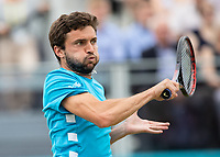 Tennis - 2019 Queen's Club Fever-Tree Championships - Day Seven, Sunday<br /> <br /> Men's Singles Final: Feliciano Lopez (ESP) Vs. Gilles Simon (FRA)<br /> <br /> Gilles Simon (FRA) gives it everything as he tries to find his way forward on Centre Court.<br />  <br /> COLORSPORT/DANIEL BEARHAM