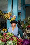 Vegetable seller, Otavalo food Market. , Ecuador, South America