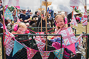 Children in their union jack trolley are pulled by dissappointed parents who voted remain - The 2016 Glastonbury Festival, Worthy Farm, Glastonbury.